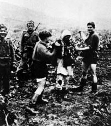 Croats taking a Serbian peasant woman to execution in Jadovno, 1942.