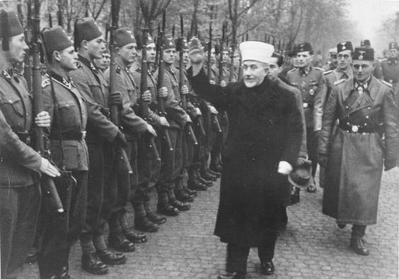 Grand Mufti of Jerusalem, Haj Amin al-Husseini greeting Bosniak SS volunteers in November 1943.